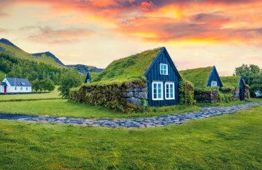 ICELAND_Icelandic countryside. Dramatic summer sunrise in Skogar village, south Iceland, Europe